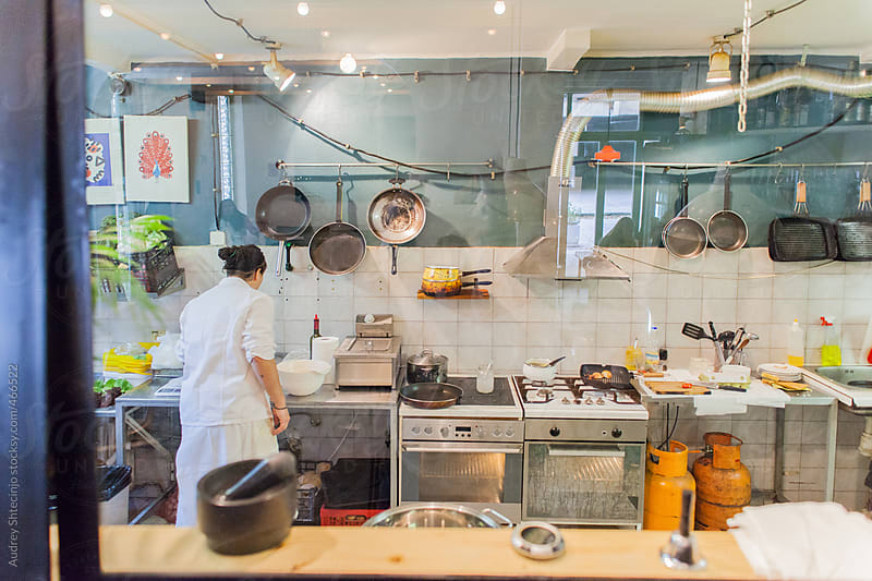 Chef cooking food in kitchen. by Audrey Shtecinjo for Stocksy United