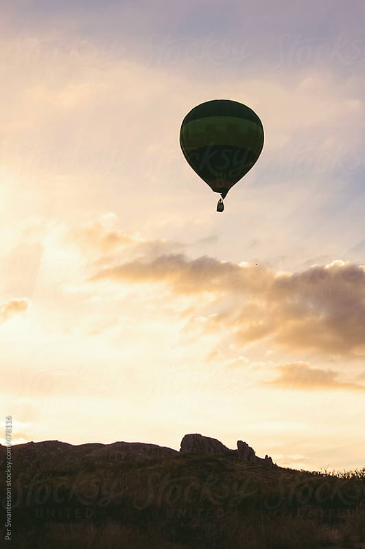 Beautiful morning sky with hot air balloon rising by Per Swantesson for Stocksy United