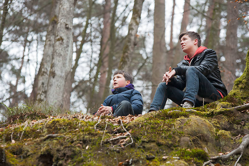 Two teenage boys in the forest by Mima Foto for Stocksy United
