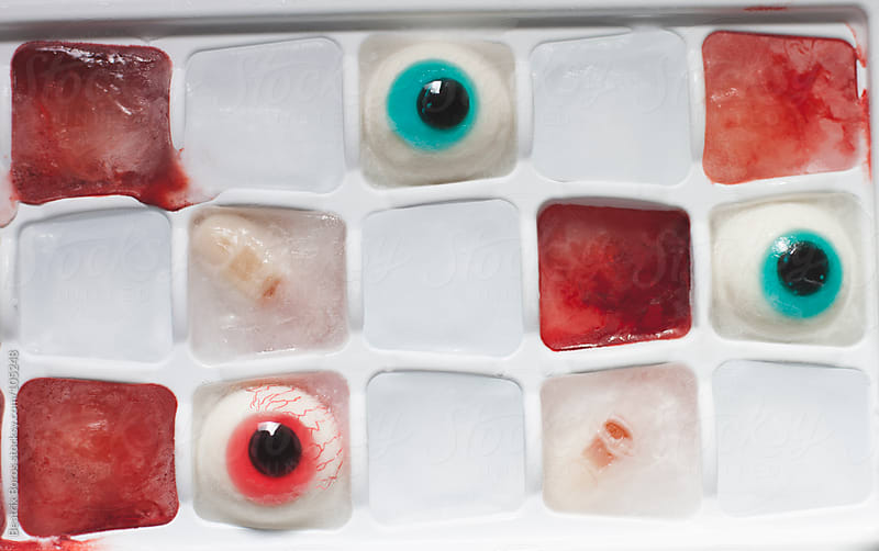 Halloween ice cube dessert with eye balls fingers and blood by Beatrix Boros for Stocksy United
