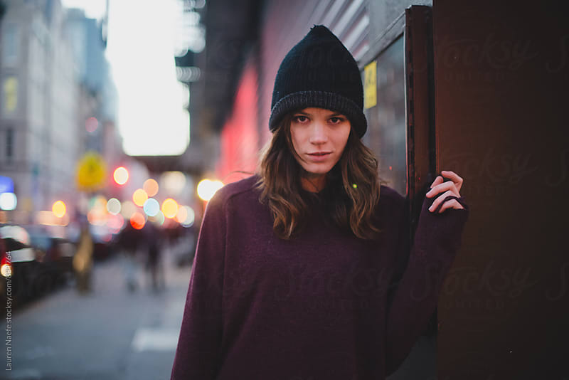 Young woman in beanie by Lauren Naefe for Stocksy United