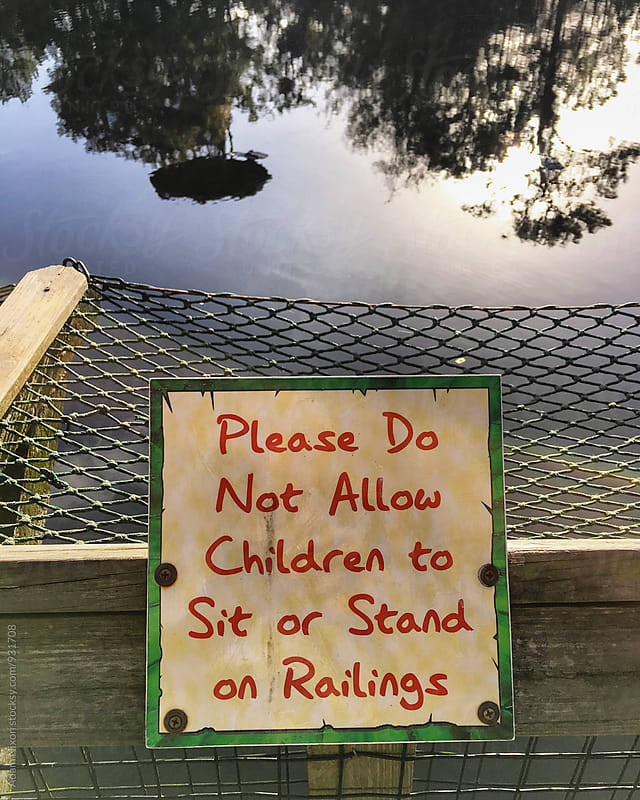 Please Do Not Allow Children to Sit or Stand on Railings by Adam Nixon for Stocksy United
