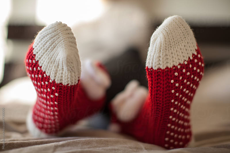 Female Feet in Christmas Socks by Mosuno for Stocksy United