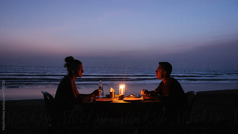 Dinner on the beach by Martin Matej for Stocksy United