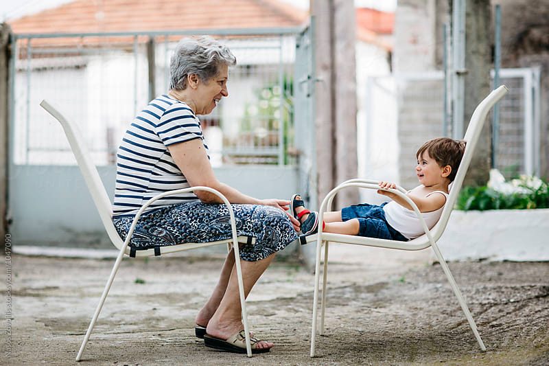 Grandmother talking to her grandson by Nasos Zovoilis for Stocksy United