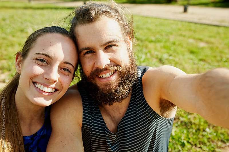 Smiling Male And Female Athletes In Park by ALTO IMAGES for Stocksy United