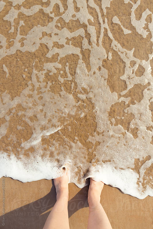 summer feet at the beach by Gillian Vann for Stocksy United