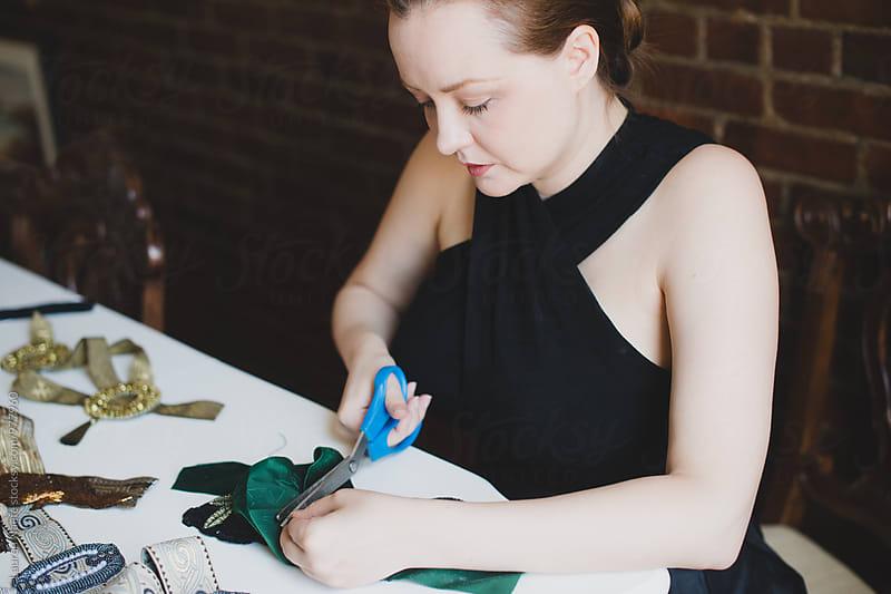 Designer working in her studio by Lauren Naefe for Stocksy United