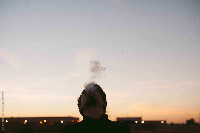 Man Smoking by Caleb Thal for Stocksy United