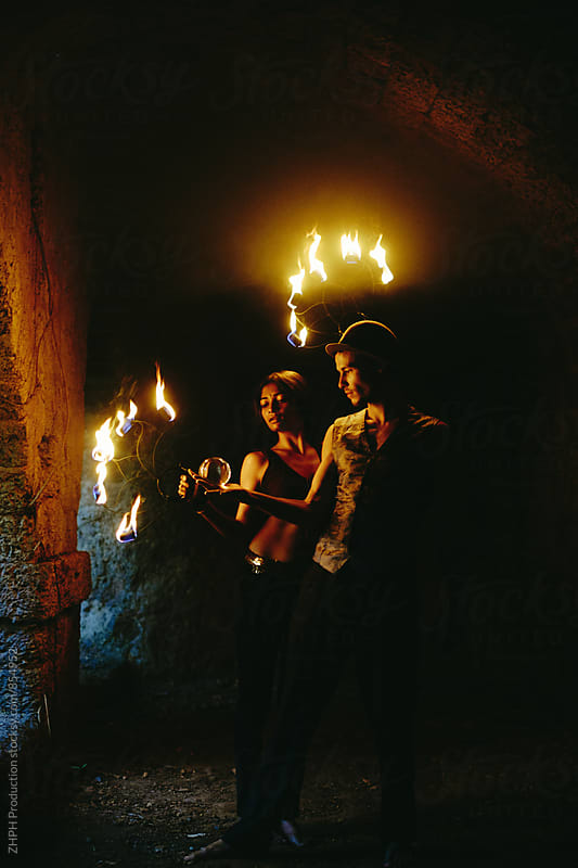 Couple of young fire performers by Artem Zhushman for Stocksy United
