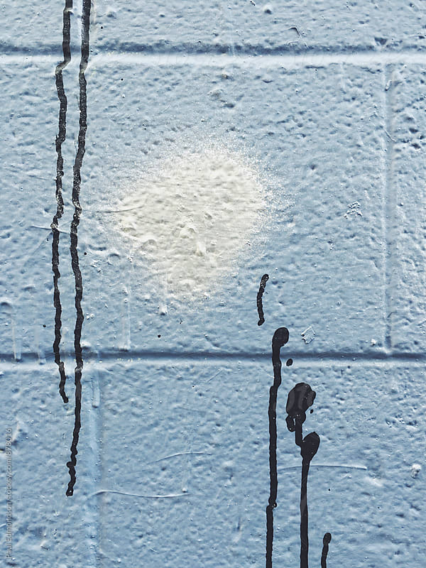 Close up of graffiti and dripping paint on wall by Paul Edmondson for Stocksy United