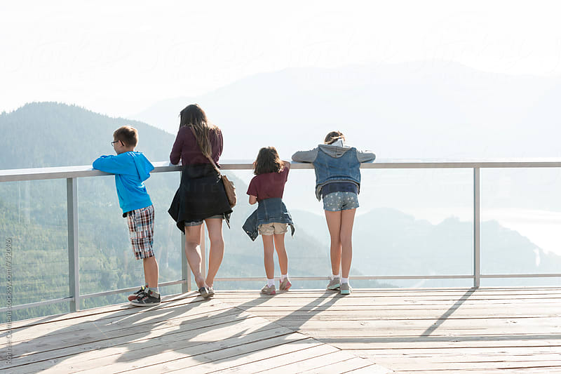 Family Looking Out From Lookout by Ronnie Comeau for Stocksy United