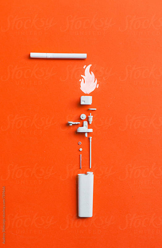 White disassembled lighter  with cigarette on orange/red background by Audrey Shtecinjo for Stocksy United