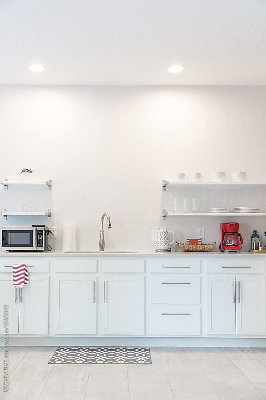 Simple and modern white kitchen. by RZ CREATIVE for Stocksy United