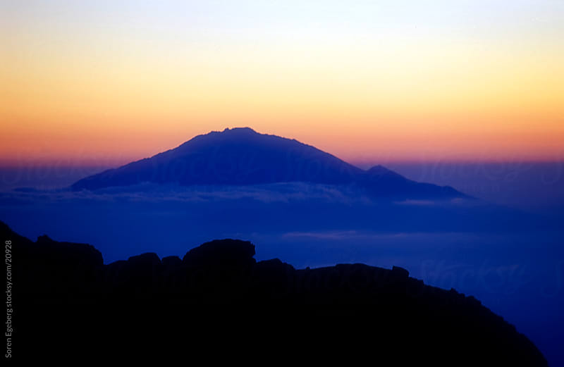 Sunset view of Mt. Meru from the mountain summit of  Mt Kilimanjaro in Africa by Soren Egeberg for Stocksy United
