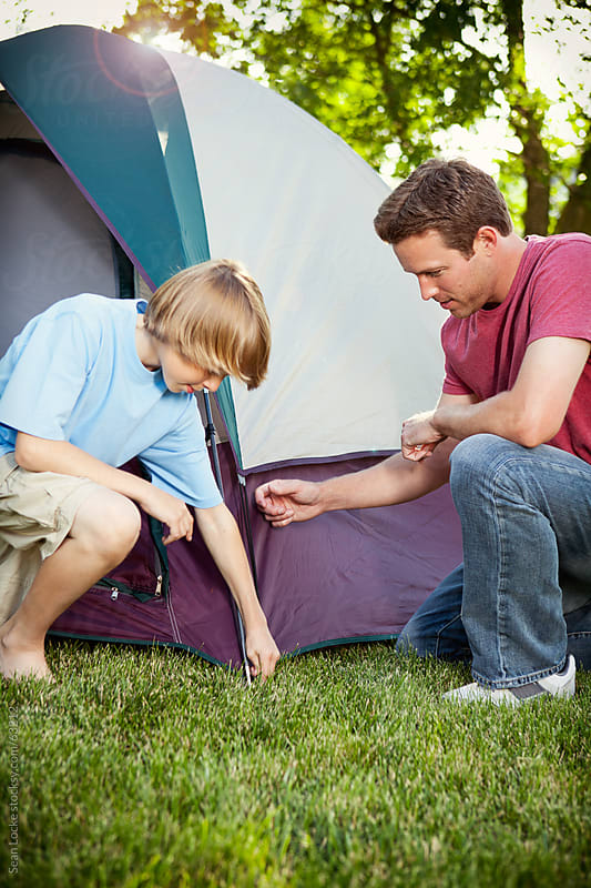 Camping: Working Together To Set Up Tent by Sean Locke for Stocksy United