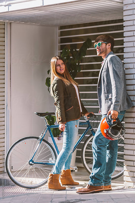 Young Trendy Couple at the Office Entrance by VICTOR TORRES for Stocksy United
