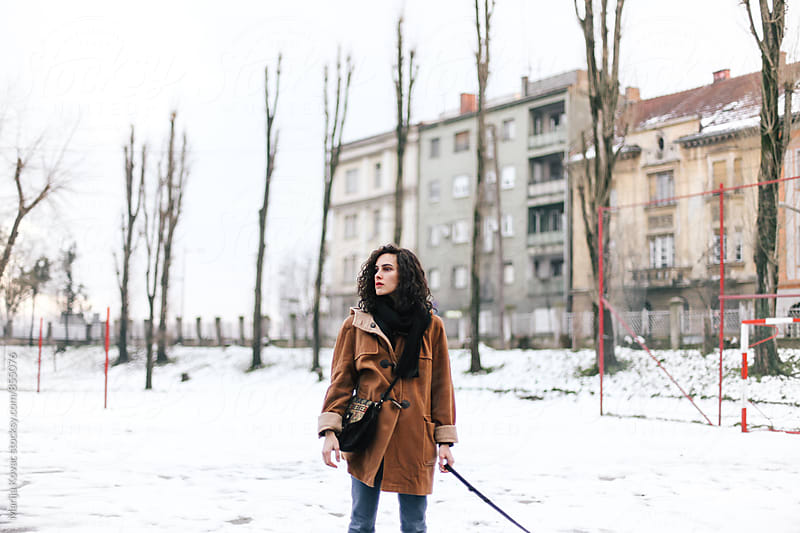 Brunette woman outdoor, winter  by Marija Kovac for Stocksy United
