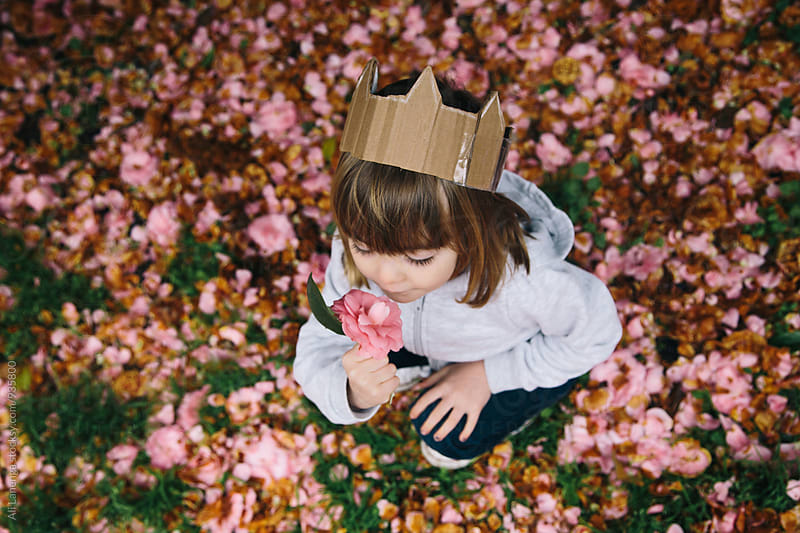 Child Smelling A Flower by Ali Lanenga for Stocksy United