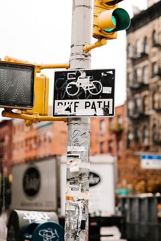 Bike lane sign and traffic light in Manhattan, Soho by Kristen Curette Hines for Stocksy United