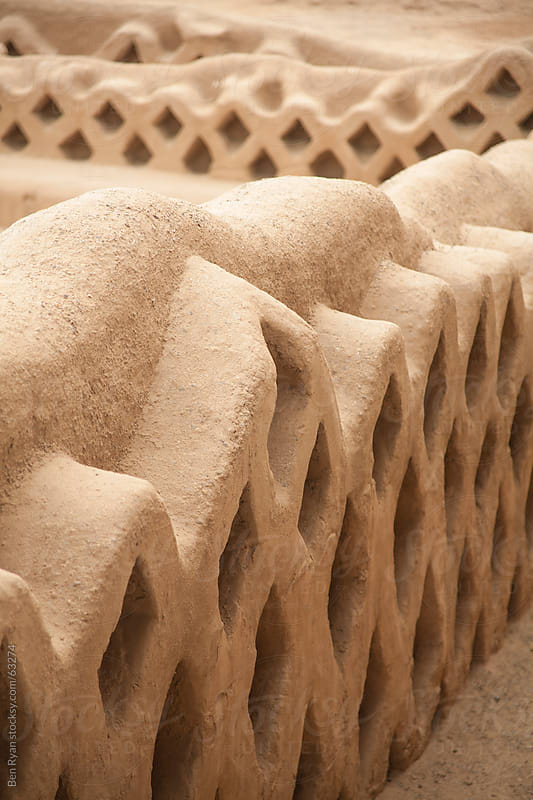 Adobe mud brick walls with lattice patterns by Ben Ryan for Stocksy United