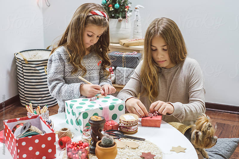 Children Wrapping Christmas Presents by Aleksandra Jankovic for Stocksy United