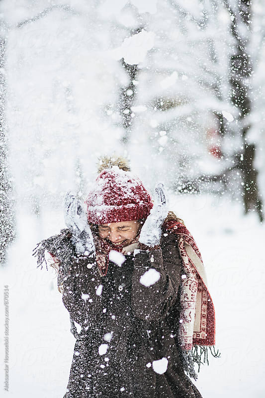 Beautiful woman enjoying the snow in the park by Aleksandar Novoselski for Stocksy United