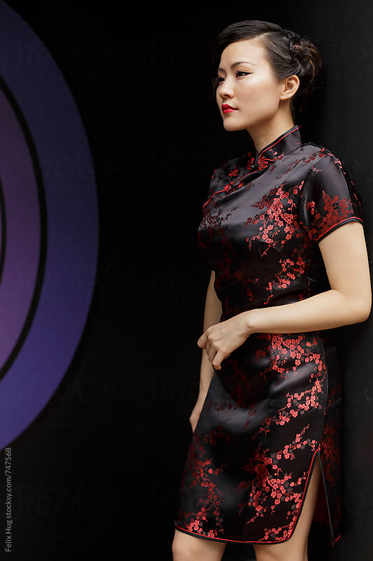 Chinese woman in cheongsam by Felix Hug for Stocksy United