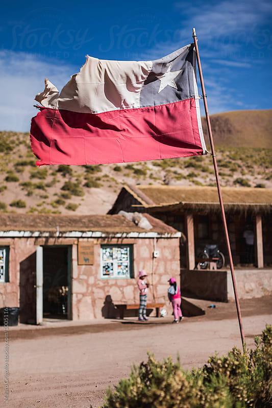 Chilean Flag in a small village around san pedro de  Atacama desert, north Chile. by Mauro Grigollo for Stocksy United