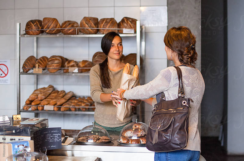 Woman Buying Bread in Bakery by Mosuno for Stocksy United