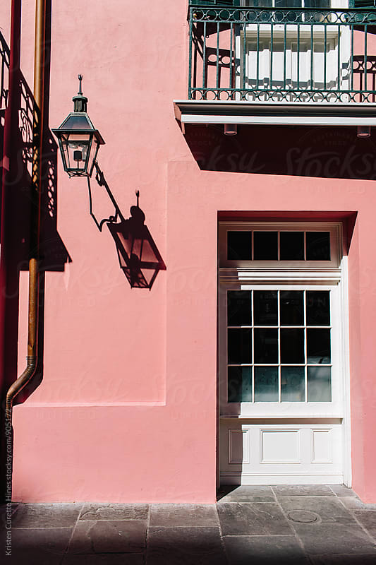 Pink pastel entrance in the French Quarters, New Orleans  by Kristen Curette Hines for Stocksy United