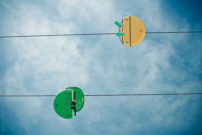 View looking up at a sky tram at an amusement park/boardwalk by Carolyn Lagattuta for Stocksy United