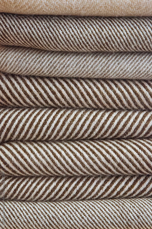 Stacked warm soft woollen scarfs. by Shikhar Bhattarai for Stocksy United