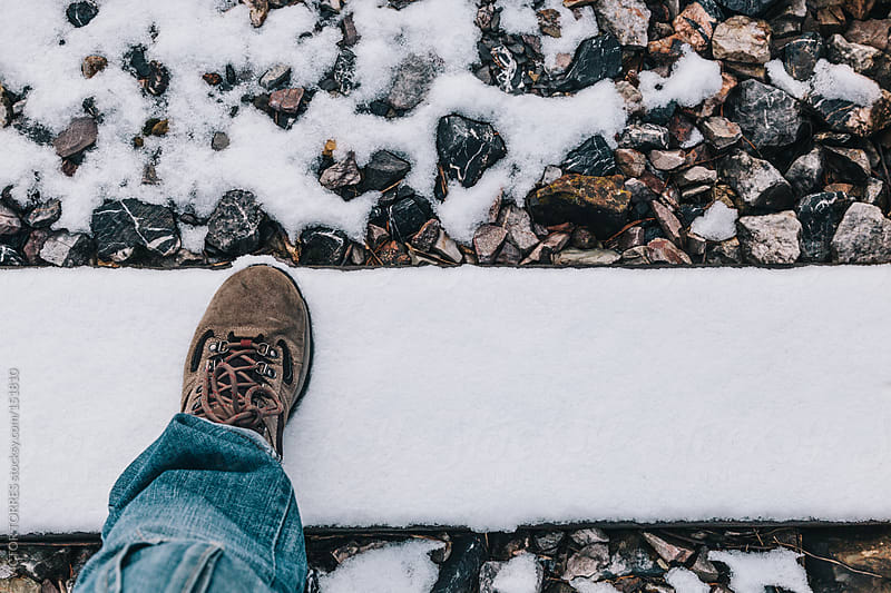 Man Stepping on Snow with Hiking Boots by VICTOR TORRES for Stocksy United