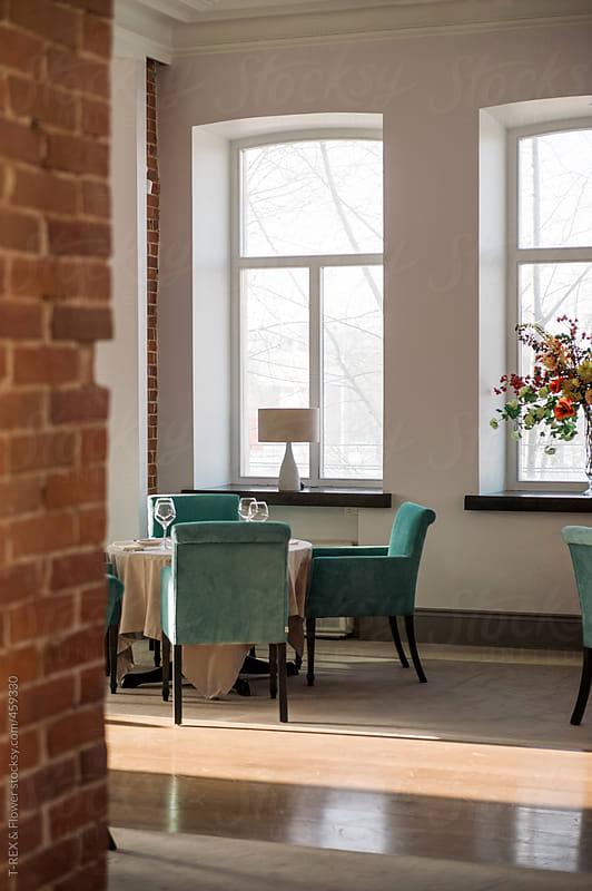 Loft style restaurant interior by T-REX & Flower for Stocksy United