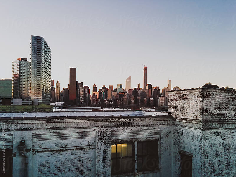 View of New York City skyline and industrial rooftop by Lauren Naefe for Stocksy United