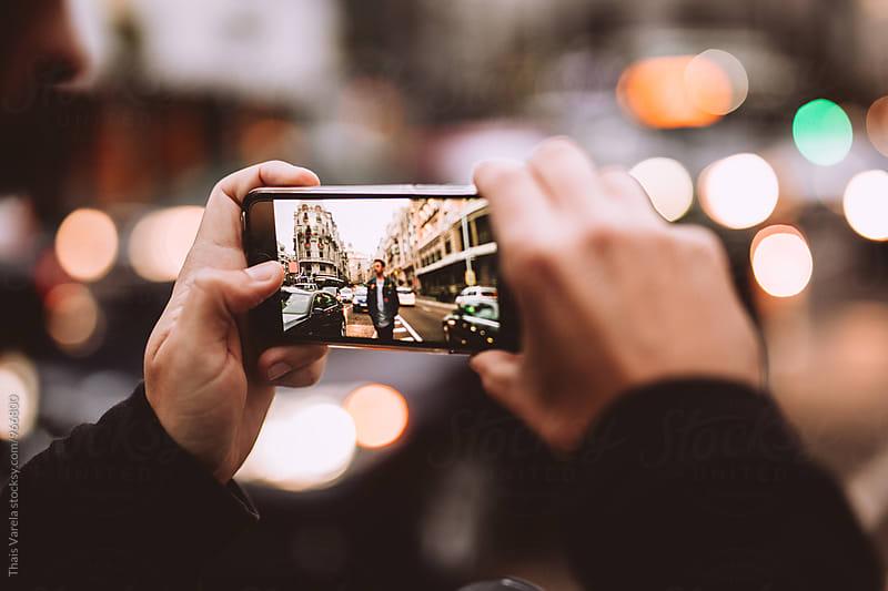 taking a picture with a mobile phone by Thais Ramos Varela for Stocksy United