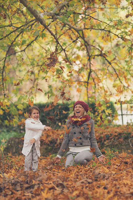 Mother and daughter playing in the park by Dejan Ristovski for Stocksy United