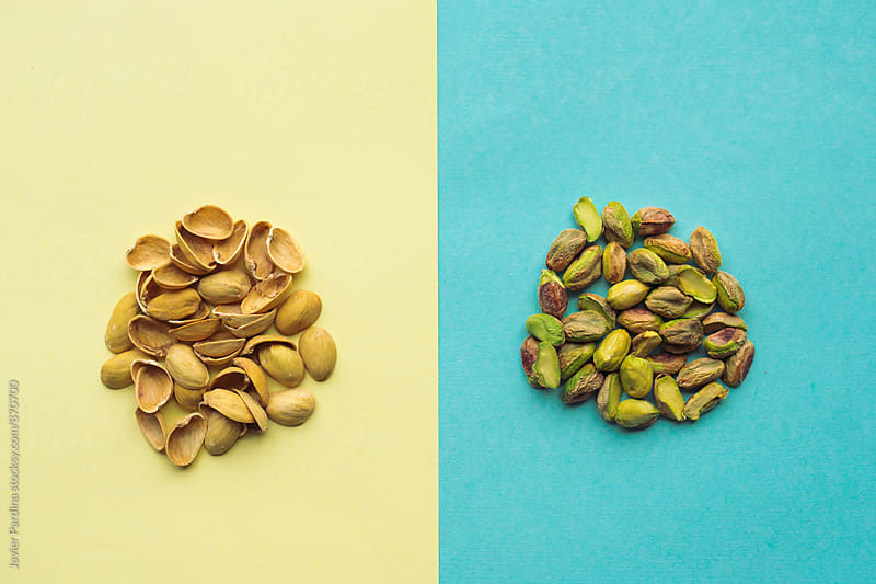 pistachios on the colored background by Javier Pardina for Stocksy United