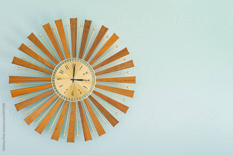 Close-up of a vintage sunburst clock. by Melissa Ross for Stocksy United