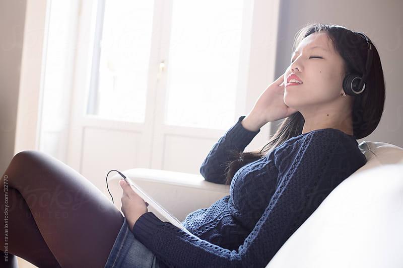 Woman enjoys listening to music by michela ravasio for Stocksy United
