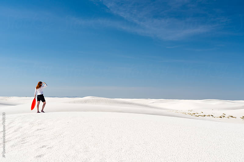 Woman Sand Sledding In White Sands National Monument New Mexico by JP Danko for Stocksy United