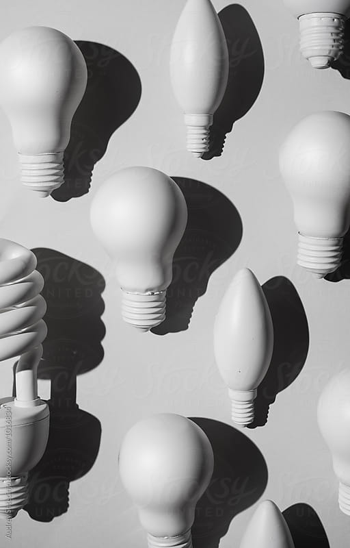 Various bulb lights organized on white background by Audrey Shtecinjo for Stocksy United