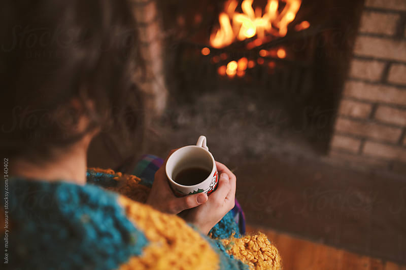 Keeping warm by the fire by luke + mallory leasure for Stocksy United