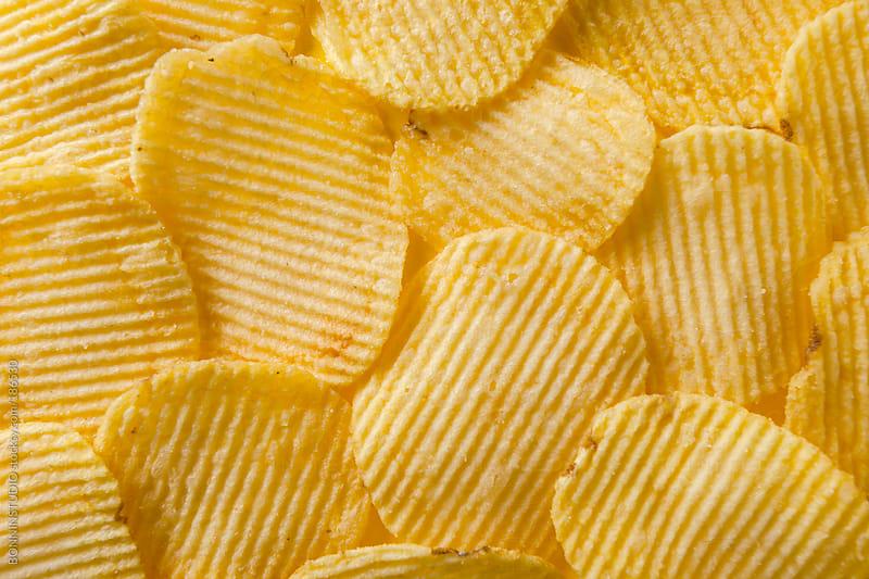 Closeup of wavy potato chips. by BONNINSTUDIO for Stocksy United