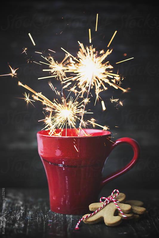 Red mug with sparklers and gingerbread men by Ruth Black for Stocksy United