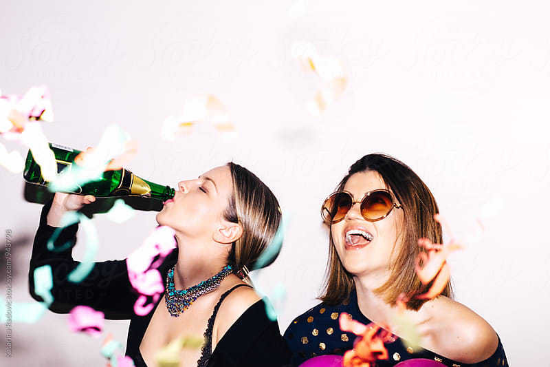 Two Female Friends Having a Crazy Time at the Party by Katarina Radovic for Stocksy United