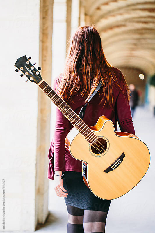 Young woman with guitar by michela ravasio for Stocksy United