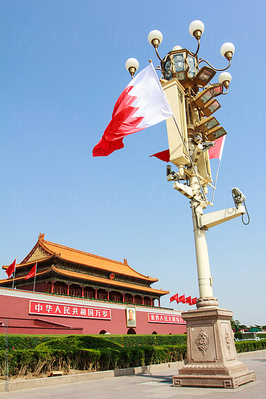 tall square lights and flags in front if Tiananmen by zheng long for Stocksy United