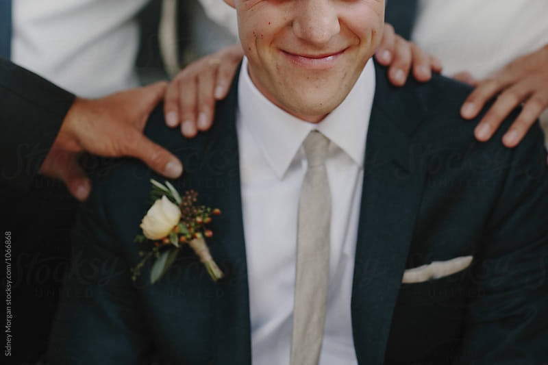 Close up of Groom Smiling by Sidney Morgan for Stocksy United